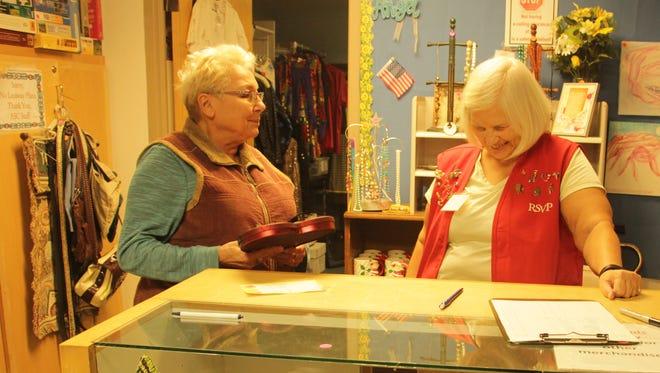 Retired Seniors Volunteer Program volunteer Haliena Leclerc, 65 years old, chats with Karen Groves at the Alamogordo Senior Center thrift shop.