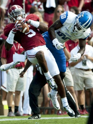 Alabama defensive back Cyrus Jones (5) intercepts a pass intended for Middle Tennessee's Ed Batties (80) during the first half of an NCAA college football game, in Tuscaloosa, Ala., on Saturday, Sept. 12, 2015. The upcoming game against Ole Miss is going to reveal any problems Alabama has on both sides of the ball. You'll know what kind of team Alabama is going to have this year by the end of the game.(Mickey Welsh/The Montgomery Advertiser )