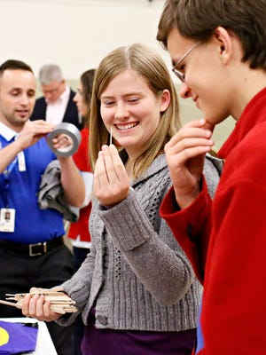 Commonwealth Charter Academy students Stacie Lins, 15, of Delta, and Nolen Petrosky, 15, of Lancaster, gather materials to build model bridges during a STEM workshop at the York County 4-H Center in West Manchester Township, Wednesday, Oct. 5, 2016. Dawn J. Sagert photo