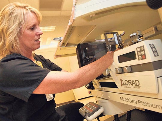 Mammography technologist Tammy McCartar prepares biopsy equipment at the Mercy Breast Cancer Center in Springfield.