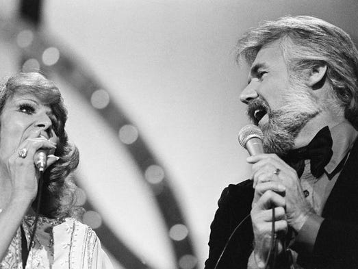 Dottie West, left, and Kenny Rogers perform together for the crowd at the 12th annual CMA Awards show at the Grand Ole Opry Oct. 9, 1978. The pair was honored as Vocal Duo of the Year in the show.