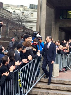 Former U.S. Attorney for the Southern District of New York Preet Bharara walks down a line of applauding well-wishers Monday, March 13, 2017, in front of the New York office where he worked until he was fired by President Donald Trump's administration over the weekend after refusing to resign.