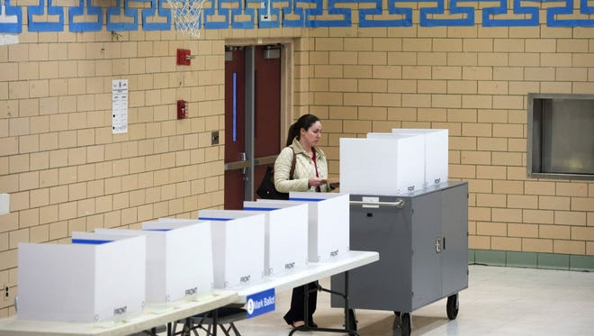 A woman votes in the Virginia primary on Super Tuesday, at a polling station inside a school gymnasium in Arlington on March 1, 2016.
