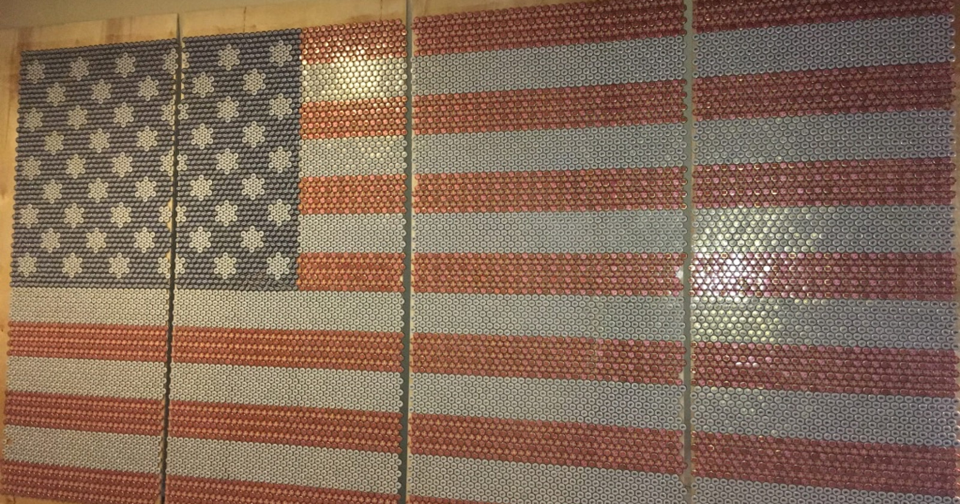 Man recycles bottle caps to create an 8-foot-tall American flag