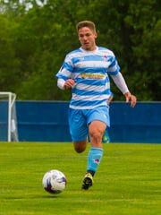 Lansing United midfielder Rafa Mentzingen moves down