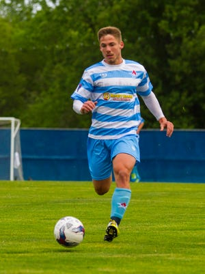Lansing United midfielder Rafa Mentzingen moves down the field before scoring the first goal of the Lansing United home game against FC Indiana May 19.
