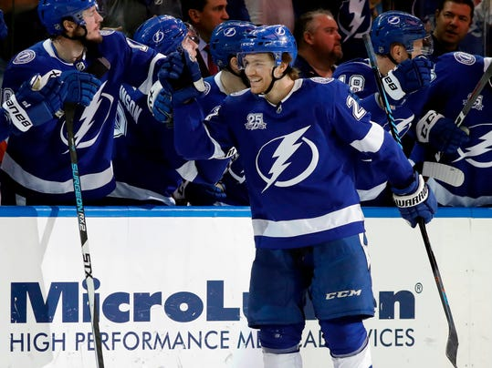 FILE - In this April 6, 2018, file photo, Tampa Bay Lightning center Brayden Point (21) celebrates with the bench after scoring against the Buffalo Sabres during the third period of an NHL hockey game, in Tampa, Fla. In the East, Boston suddenly looks like the team to beat, Pittsburgh has won the Stanley Cup two years in a row and awakened from a midseason funk and Tampa Bay has shown flashes of being unstoppable. (AP Photo/Chris O'Meara, File)