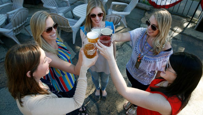 Clockwise from left, Jessica Pizzutelli of Pittsford, Jill Pasley of Pittsford, Sheri Tiernan of West Henrietta, Hayley Swetman of Henrietta and Adena Miller of Rochester raise a toast at Fairport Brewing Company.