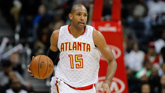 Al Horford dribbles against the Charlotte Hornets in the third quarter at Philips Arena.