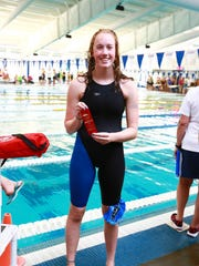 Ella Miller of the EDGE Swim Club poses with her Heat