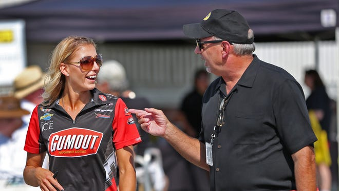 NHRA driver Leah Pritchett, left, talks with Gumout representative Ron Schneider before she goes to sign autographs for fans at Lucas Oil Raceway, Friday, September 4, 2015.