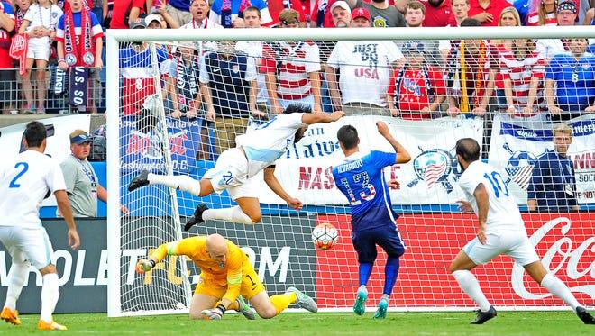 Guatemala's Carlos Ruiz (20) goes airborne after colliding with United States goalkeeper Brad Guzan (1) during the second half at Nissan Stadium, Friday, July 3, 2015, in Nashville, Tenn. USA won 4-0.