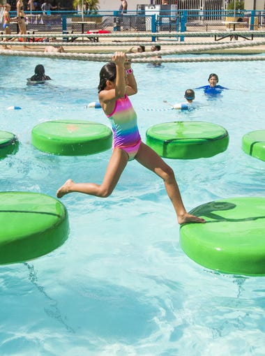 People enjoy playing in the water on a hot day at Golfland Sunsplash water park in Mesa, Monday, July 9, 2018.