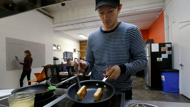 Hampton Creek Foods pastry chef Ben Roche prepares French toast made with Just Scramble at the company's office in San Francisco.