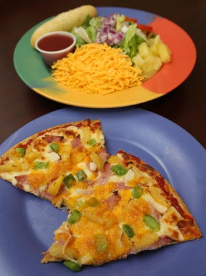 Green peppers and onions set the Aloha Pizza apart at Garden Cafe.