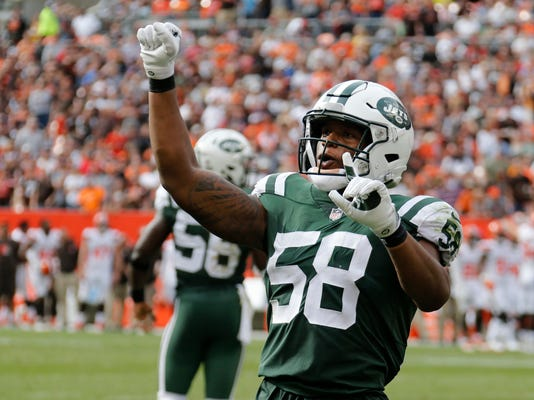 New York Jets inside linebacker Darron Lee celebrates after stopping the Cleveland Browns on 4th and one during the second half of an NFL football game, Sunday, Oct. 8, 2017, in Cleveland. (AP Photo/Ron Schwane)