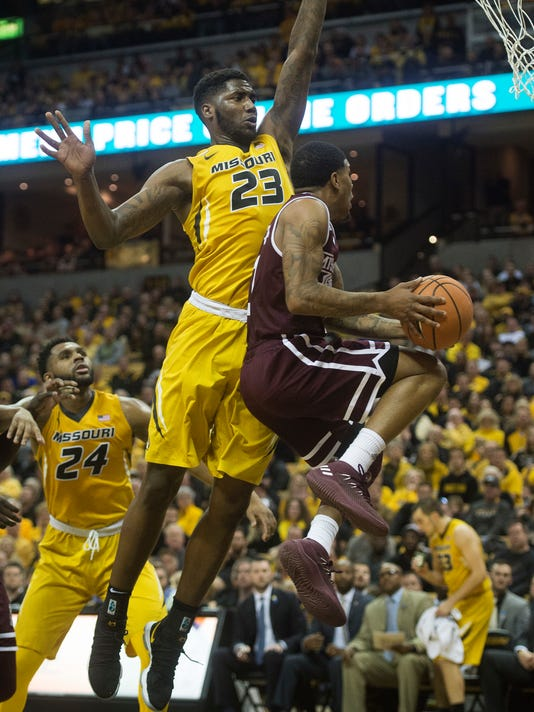 Mississippi State's Lamar Peters, right, shoots past Missouri's Jeremiah Tilmon, left, during the first half of an NCAA college basketball game Saturday, Feb. 10, 2018, in Columbia, Mo. (AP Photo/L.G. Patterson)