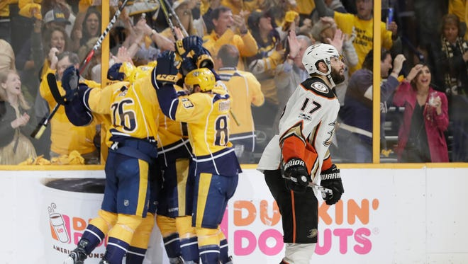 Ducks center Ryan Kesler skates past Nashville Predators players as they celebrate a goal by Filip Forsberg during the third period.