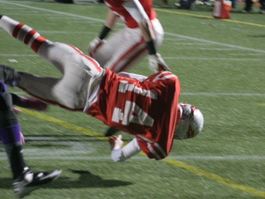 Bellevue's Jalen Santoro dives into the endzone against
