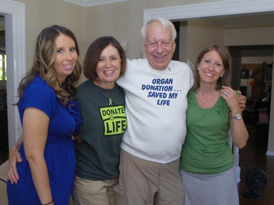 Cancer survivor and heart transplant recipient Jerry Berkesch with wife Nancy and daughters Kari, right, and Shellie.