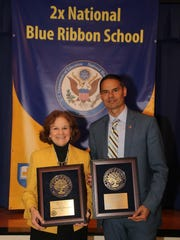 Margaret Dames, schools superintendent for the Archdiocese of Newark, and Our Lady of the Lake Principal Ben Ronquillo celebrate the Verona school's Blue Ribbon of Excellence Award.