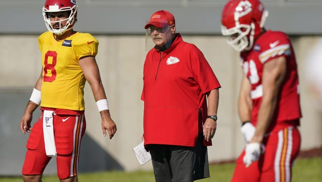 Kansas City Chiefs head coach Andy Reid watches a drill during an NFL football training camp session in Kansas City.