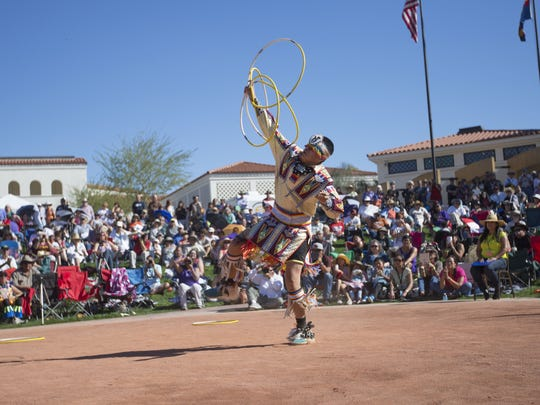 Tyrese Jenson, 16 of the Navajo/Pima-Maricopa nations performs his hoop dance in competition during the Heard Museum World Championship Hoop Dance Contest, Sunday, February 8th, 2015, in Phoenix. Jenson went on to finish in first place in the Teen Division with a score of 239 points.