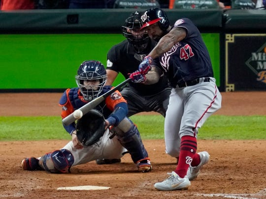 Washington Nationals' Howie Kendrick hits a two-run home run against the Houston Astros during the seventh inning of Game 7 of the baseball World Series Wednesday, Oct. 30, 2019, in Houston. (AP Photo/Eric Gay)