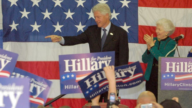 Former President Bill Clinton points to a person after walking into Fire Station No. 1 in Richmond on March 18, 2008.