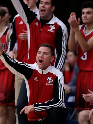 New SPASH boys basketball coach Jon Krull, top, has learned from some of the best coaching mentors in the state, including Scott Anderson, kneeling.