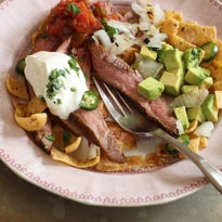 This July 13 photo shows flank steak Frito pie in Concord, N.H. This dish is from a recipe by J.M. Hirsch.
