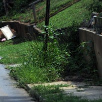 Dirt and debris cover a sidewalk on Fulton Street in downtown Asheville