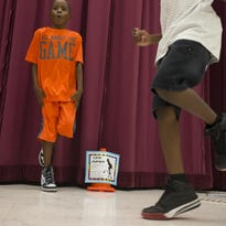 Eric Chen takes his pulse, August 5, 2015, during physcial educaiton class at Tarwater Elementary School, 2300 S. Gardner Drive, Chandler.
