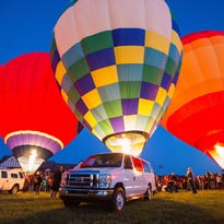 Walk among glowing hot air balloons in Gallatin