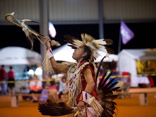 Dennis Rogers, a Navajo Northern Traditional dancer who lives in Kansas, dances after the grand entry during the 2016 Thunder on the Beach Powwow. This year's event runs Friday through Sunday at the Indian River County Fairgrounds in Vero Beach.