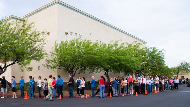 Voters wait in line to cast their ballots at Red Mountain United Methodist Church in Mesa March 22, 2016. People waited up to 2-1/2 hours at this location.