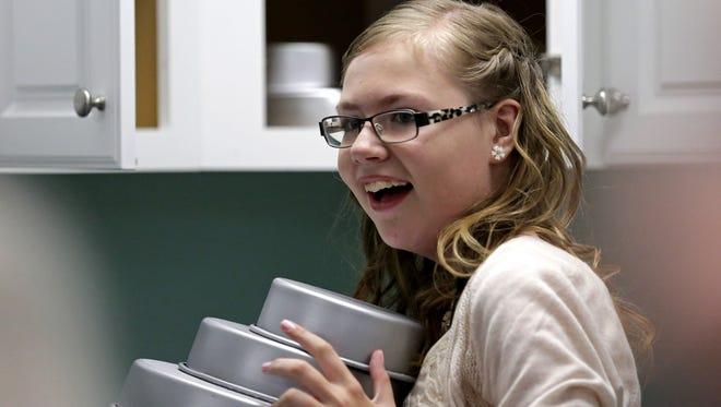 Emily Koehler, 12, inspects her new bakery in family's Hilbert home on Sunday.