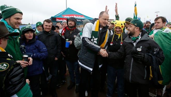 Portland Timbers owner Merritt Paulson, center, meets with fans before the MLS soccer Western Conference final playoff match against FC Dallas Sunday, Nov. 29, 2015, in Frisco, Texas.
