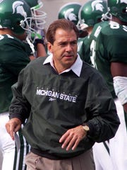 Nick Saban looks over his team before it beat third-ranked Michigan, 34-31, on Oct. 9, 1999 at Spartan Stadium during his final season in East Lansing.