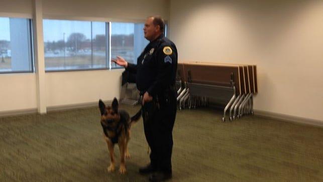 Des Moines Police Sgt. Mark Miller and Emir demonstrate tracking skills