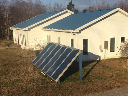 Richard Ayers incorporated both solar thermal panels and photovoltaic panels into the design of his home in Northampton County.