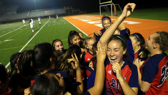 Veterans Memorial players celebrate after defeating San Antonio Harlandale 2-1 in the girls soccer Region IV-5A quarterfinals on Tuesday in Beeville.