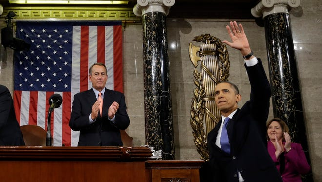 After giving his State of the Union address on Feb. 12, President Obama leaves Congress and House Speaker John Boehner.