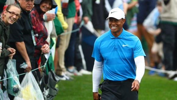 Apr 7, 2018; Augusta, GA, USA; Tiger Woods smiles as