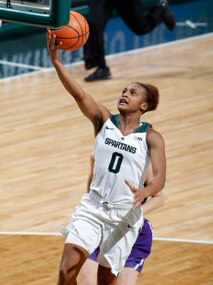 Michigan State's Shay Colley gets a fast-break layup against Northwestern, Wednesday, Jan. 3, 2018, in East Lansing, Mich. MSU won 81-51.