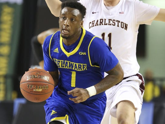 Delaware guard Kory Holden pushes the ball up-court in front of Charleston's Evan Bailey during the 2016 CAA tournament in Baltimore.