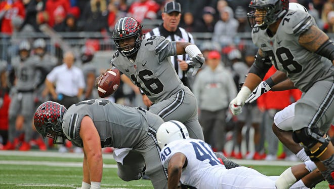 Ohio State quarterback J.T. Barrett looks for running room in Saturday's showdown with Penn State.