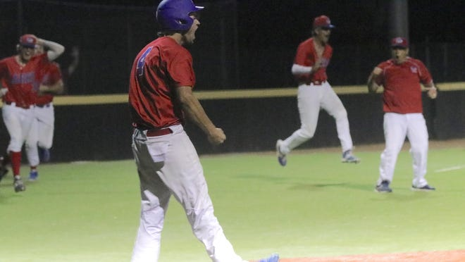 Palmer Hutchison reacts after scoring the winning run for the Hays Larks on Friday night against the Denver Cougars.