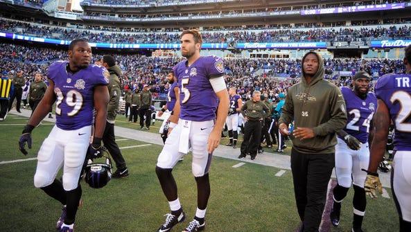 Baltimore Ravens quarterback Joe Flacco (5) reacts