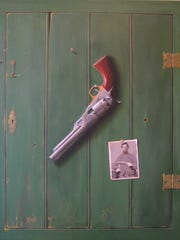 This Colt pistol apears to be hanging on a boor, but it's actually a painted trompe l'oeil piece by Alan Weston, Invited International Artist at this year's Great Gulfcoast Arts Festival.